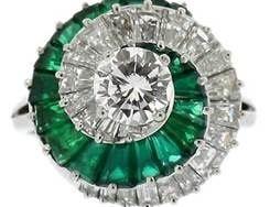Cartier diamond, emerald, and platinum ring