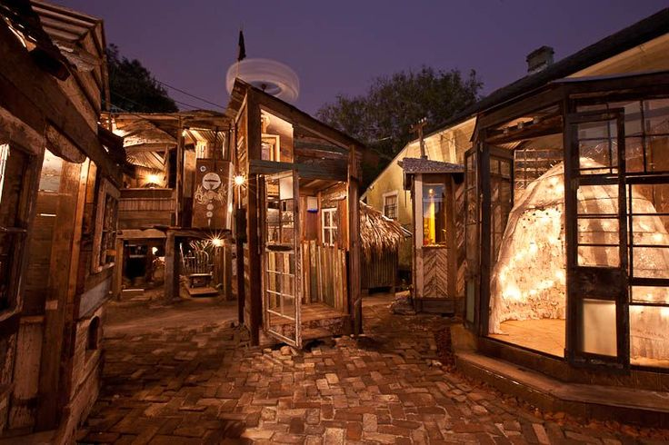 Dithyrumbalina....  is a decaying 150-year-old house transformed into a 'temporary village of playable musical houses with interactive instruments embedded into the walls, floors and ceilings of structures'. By Swoon.