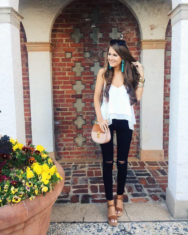 love this simple outfit - black pants, white top, Chloe bag, tassel earrings