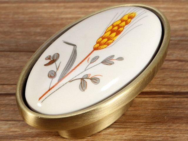 Gałka porcelanowa w złotej oprawie