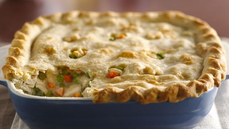 Enjoy this classic pot pie that's made using chicken, peas and carrots topped with puff pastry – a tasty dinner recipe. Use our classic pie crust recipe to make this the best homemade chicken pot pie!