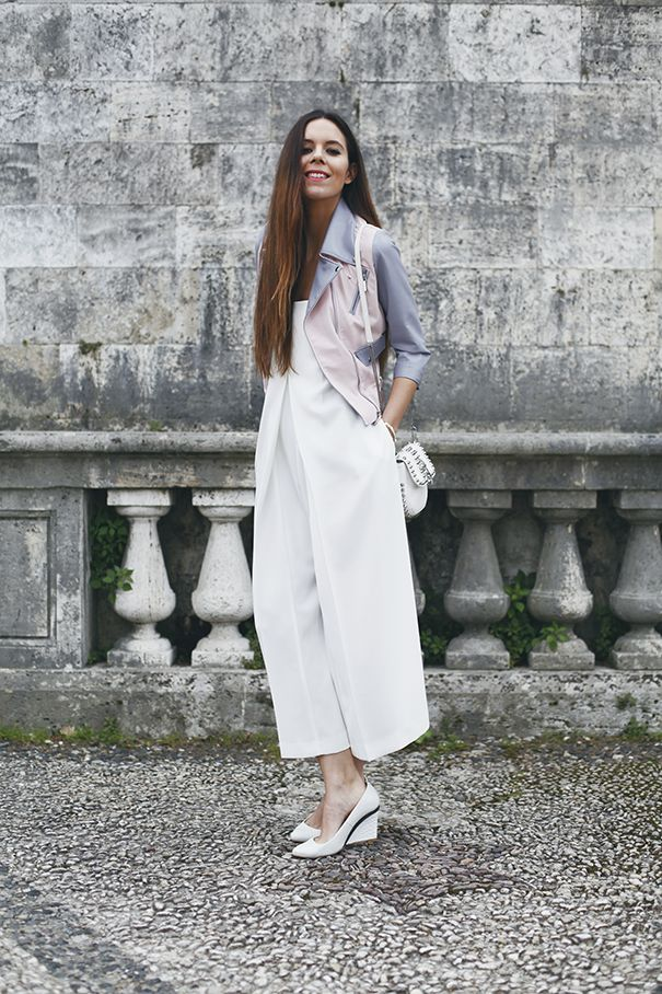 A pair of white culottes and some futuristic heels, plus a white bag and a colourful biker jacket to top it all off. The perfect spring time look!