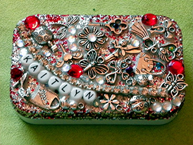 DIY Money tin for a little girl. Glue charms and glitter to the lid of an Altoids tin. Simple project!