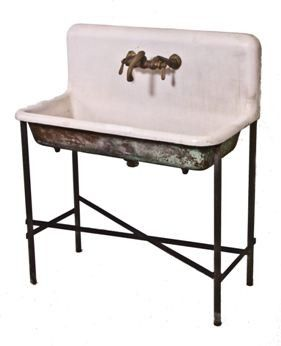 We could custom fabricate an iron sink base for the laundry sinks we have been looking at as well, with a shelf below.
