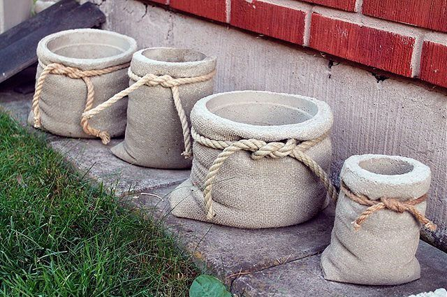 concrete planters: looks like cloth grain sacks with hemp rope and everything. these are so cool!