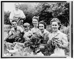 Some victory gardeners proudly distplaying their vegetables. 1942 or 1943