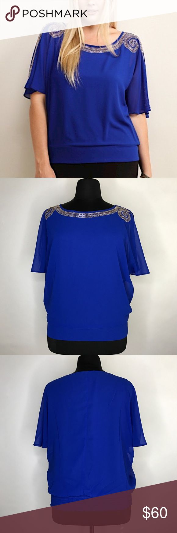 Plus Size Holiday Top Holiday blues take on a whole new meaning with this top. Royal blue loose fit top with detailed embellishment at neckline and shoulder. Sheer split sleeves that flutter ever so, and a banded hem. Romance for all your holiday occasions! Soie Blu Tops