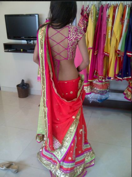 beautiful fuchsia lehenga and backless blouse