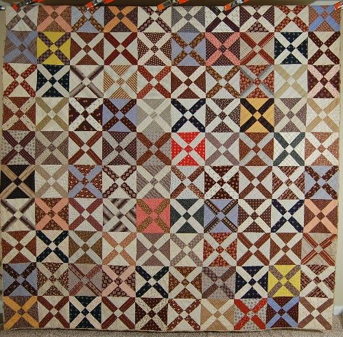 "This ELEGANT cotton 1870's (some fabrics are much earlier) ""old Italian block"" quilt is hand pieced and hand quilted, with an eye catching overall lattice design. The quilt came out of Berks County, Pennsylvania."