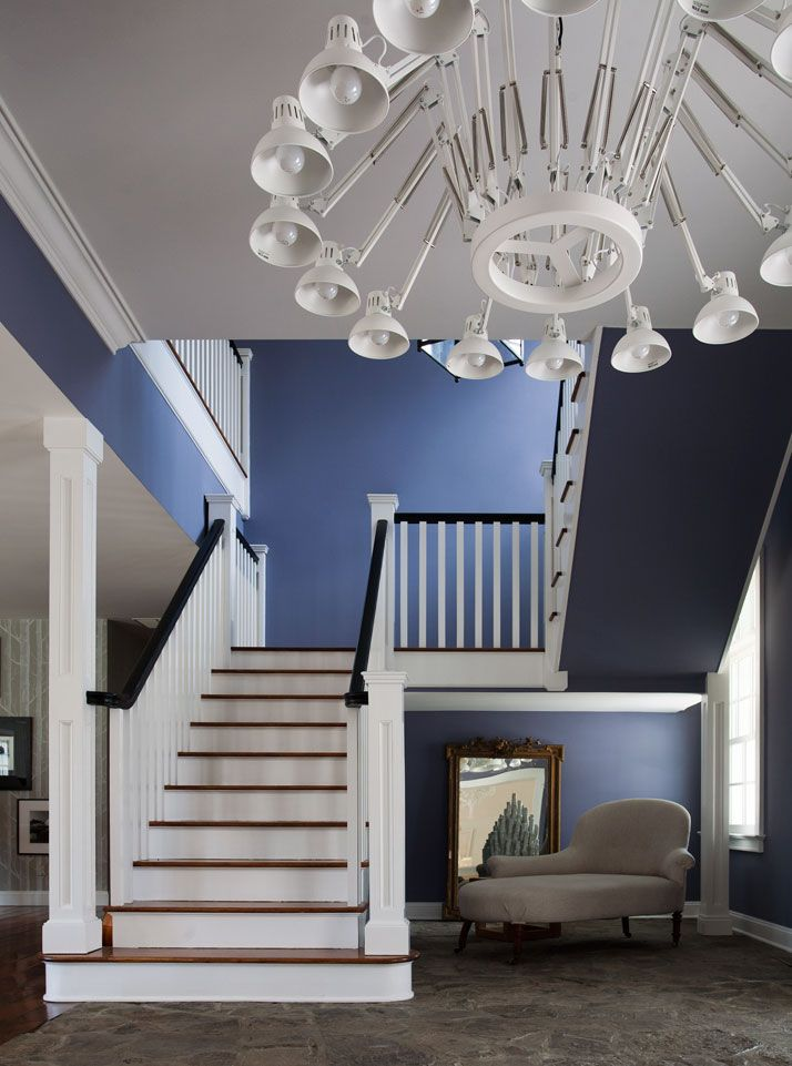 Classic staircase, but the wall color is fresh and the lighting quietly screams MODERN.
