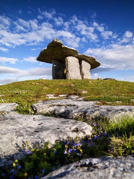 The Poulnabrone dolmen is a portal tomb in the Burren, Co. Clare, Ireland. Dating back to the Neolithic period, probably between 4200 BC and 2900 BC. It is situated 8 km south of Ballyvaughan, 9.6 km north-west of Kilnaboy.