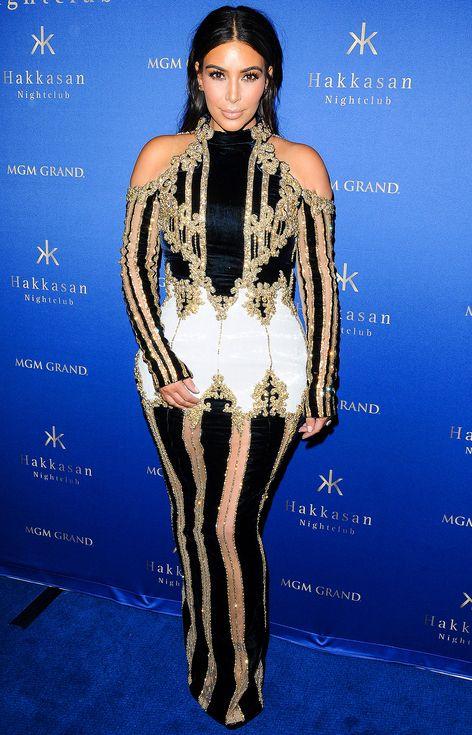 Kim Kardashian in a sheer beaded black, gold and white ...