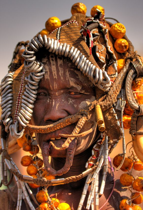 Africa | 'African Puzzle'. Mursi woman, Ethiopia | © Cezary Filew