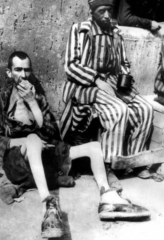 Two emaciated prisoners after the liberation of Buchenwald concentration camp on 13 April 1945 by the 3rd US Army.