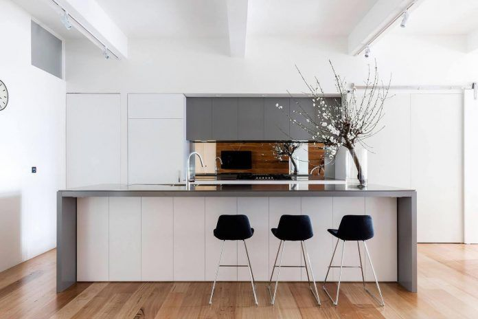 Modern white and gray kitchen   Roof warehouse redesign with beautiful arched windows - CAANdesign