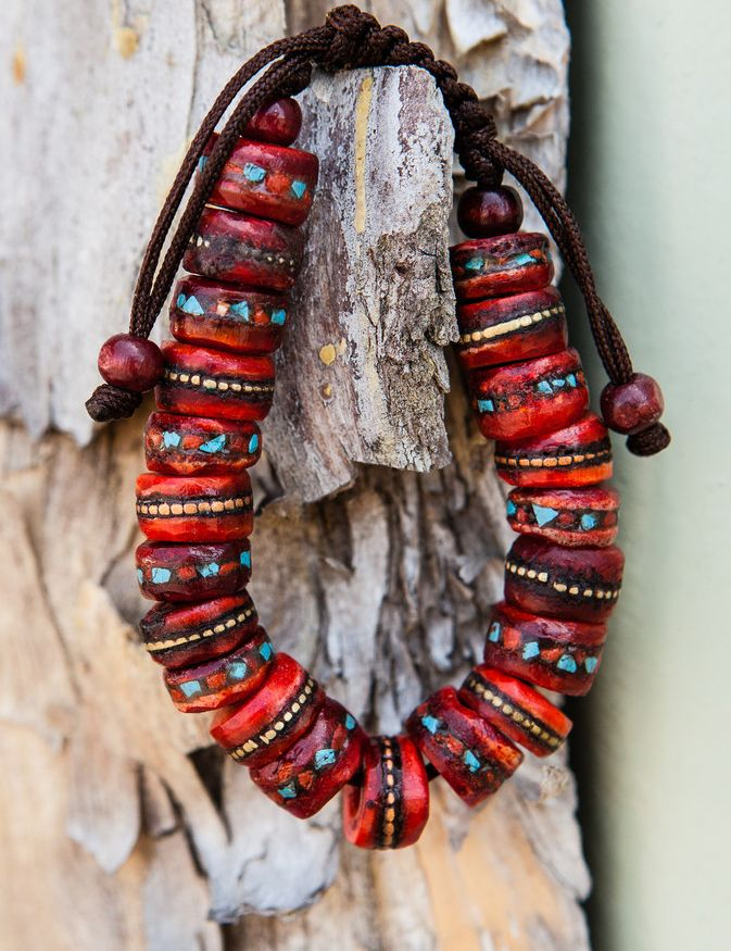 The Tibetan Healing Bracelet is worn to help the body balance its essential energy. It is hand-crafted from Yak bone and inlaid with coral and turquoise, known for their healing properties. The three metals: copper, nickel and brass help promote healthy blood flow and circulation.