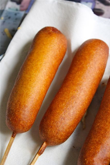 Homemade corn dogs- I used too much batter at first and it sorta fell all to one side- so, I think less is more- just make sure it's covered/ sealed.  And the leftover batter makes YUM hush puppies- just spoon them into the hot oil!!