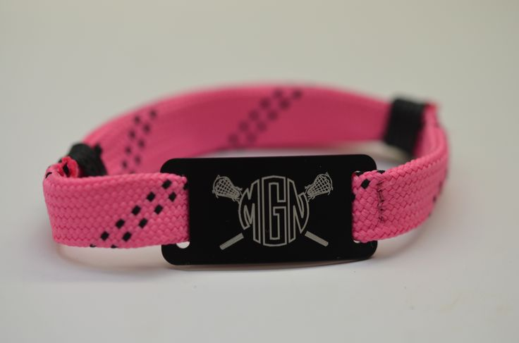 Look at this awesome NEW lacrosse shooting string bracelet design we have come up with! Makes an awesome personalized lacrosse gift for lax girls. This bracelet features our pink with black bracelet with a black slider. #monogram #girlslacrosse