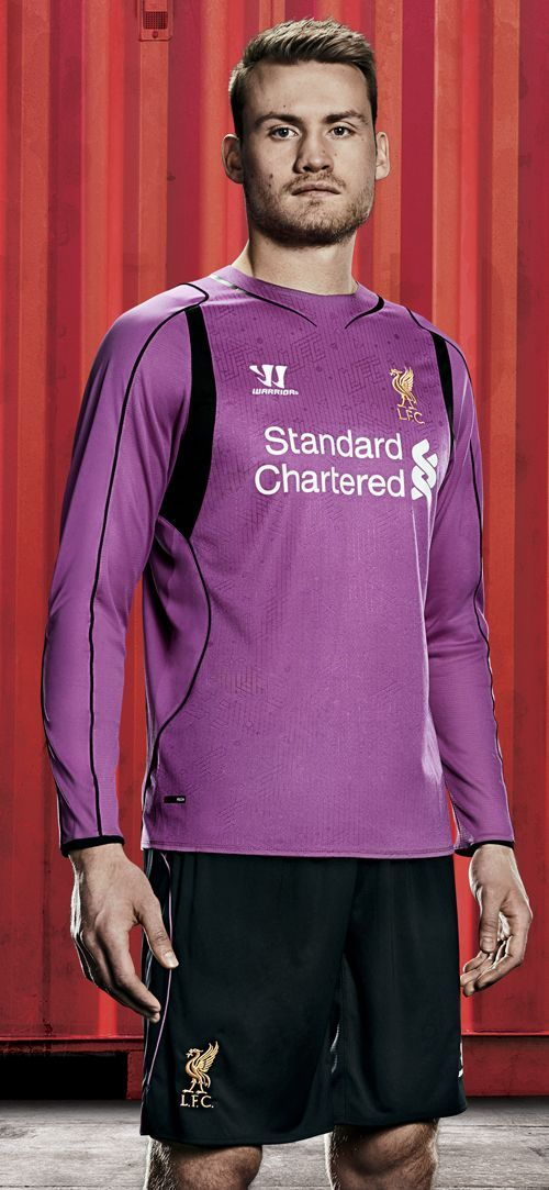 Simon Mignolet models the new #LFC home kit for the 2014/15 season