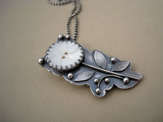 Pendant | Rebecca Bogan ~ AdobeSol.  Vintage mother of pearl button with sterling silver.