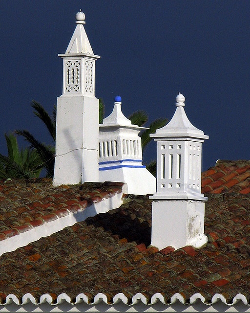 Portuguese decorative chimneys- look at the intricate detail on something at least 30 or 40 feet up in the air- the birds applaud the effort