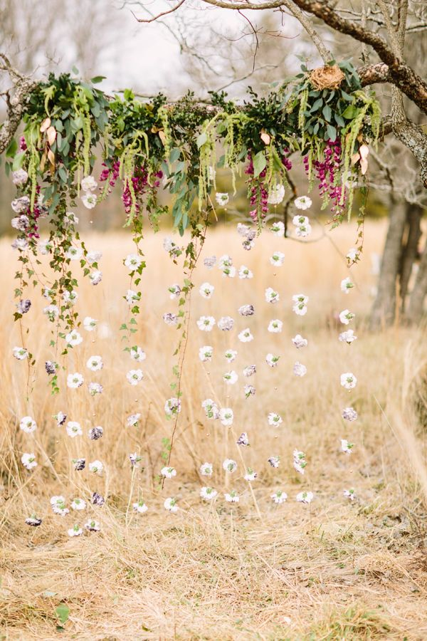 hanging flower backdrops - photo by Erika Lynn Photography http://ruffledblog.com/berry-toned-spring-wedding-editorial