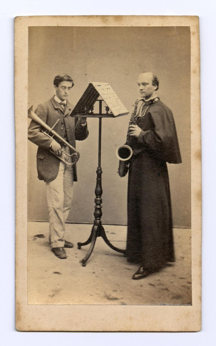 Carte-de-visite depicting two musicians, one holding a tenor horn and the other a saxophone, by an unknown photographer
