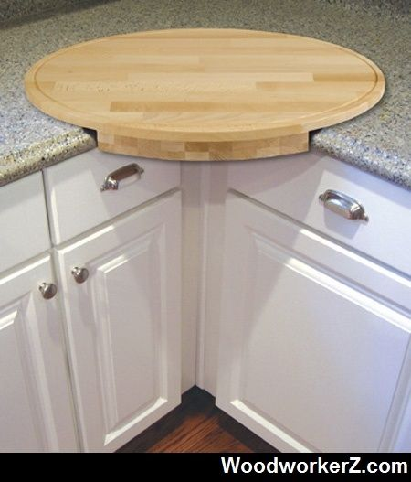 Corner cutting board - you can put the trash can under it and sweep the scraps into it. www.woodworkerz.com