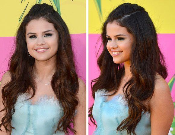 Selena Gomez optou por manter os fios soltos, prendendo apenas a franja. Sem desfiar muito o cabelo, ela jogou a mecha para trás e prendeu deixando um topete suave, com volume bem discreto. No comprimento, ondas marcadas para dar um ar de diva ao penteado. #Capricho
