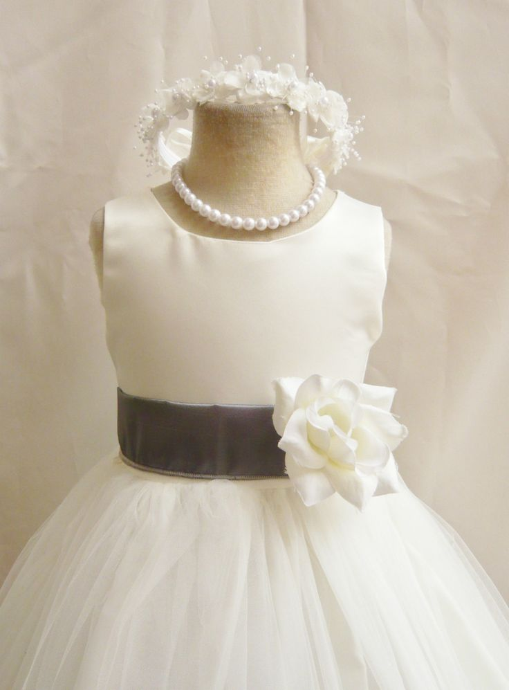 Whatcha think? Simple flower girl dress with charcoal gray sash and a matching headband. It's only $23.00...