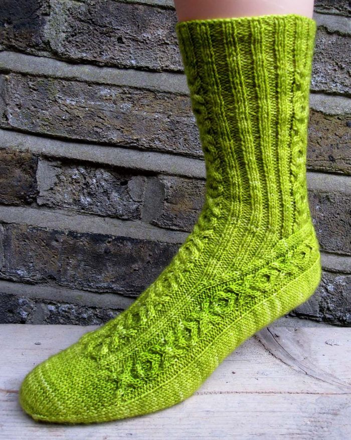 "Free Knitting Pattern Hugs and Kisses Socks - These Love and Liquor socks are named for XOXO cable design (""Love"") and the chartreuse color (""Liquor""). Worsted weight yarn. Designed by General Hogbuffer"
