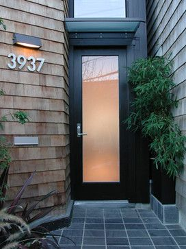 Cary Bernstein Architect - Choy 1 Residence modern entry with black & glass door, light above modern house numbers - cbstudio.com
