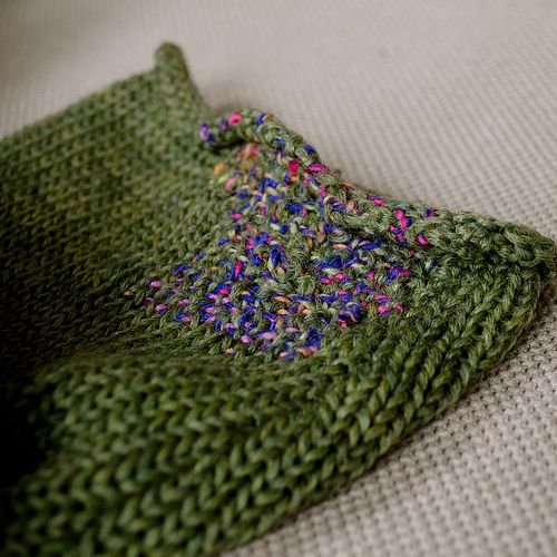 Green sweater with multicoloured repair at cuff | Mending | Darned | Stitch detail