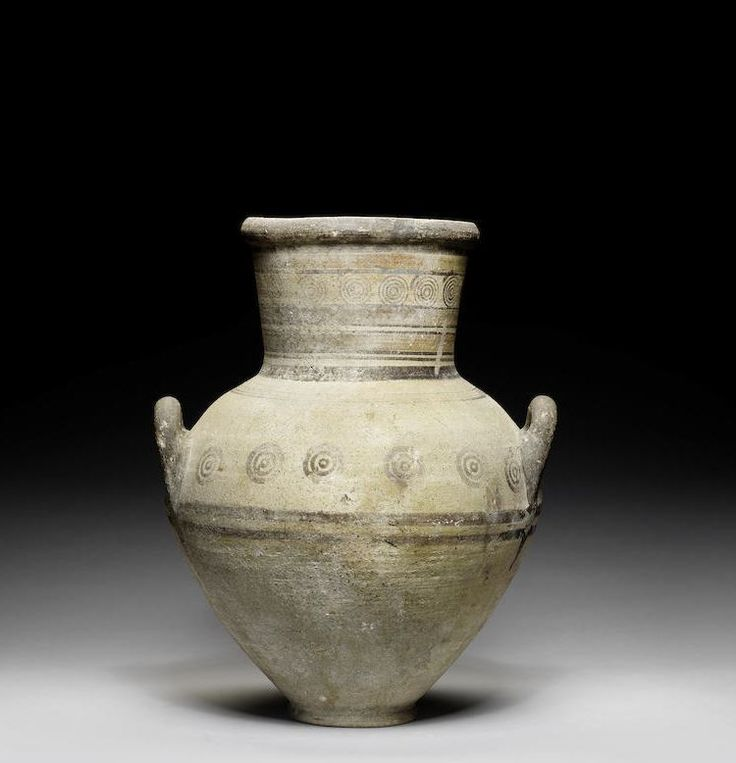 Cypriot bichrome ware amphora, Cypro-Archaic, 750-600 B.C. The flaring neck decorated with encircling crimson and umber bands and a band of repeated concentric circles, the piriform body with upturned handles decorated with parallel bands and concentric circles, 48 cm high. Private collection