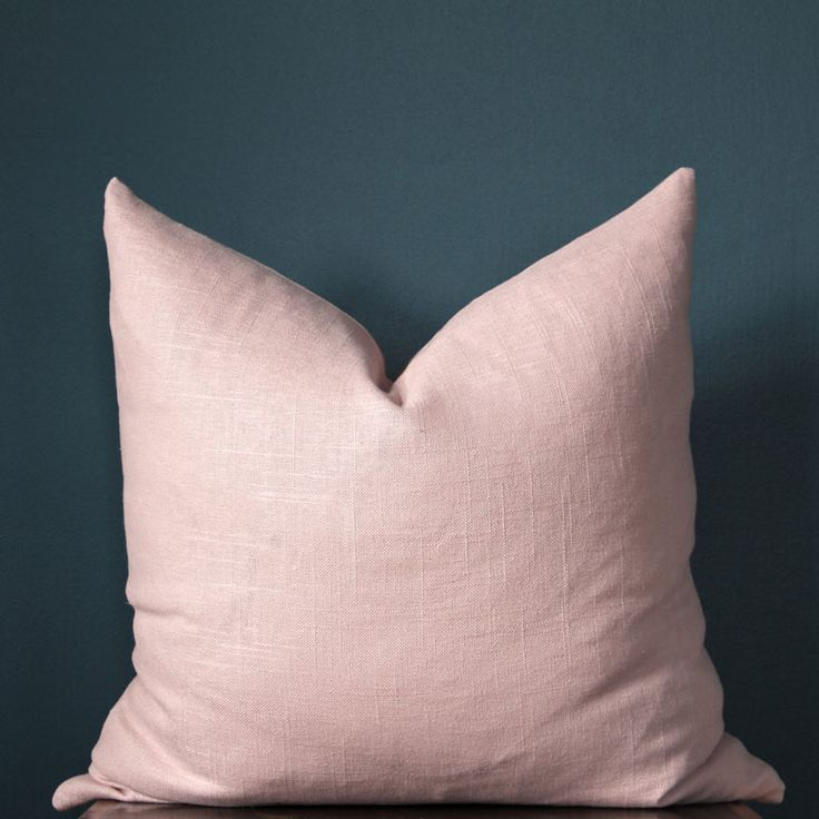 Made from a linen-blend fabric, this modern blush pink pillow cover is soft to the touch and easy on the eyes.
