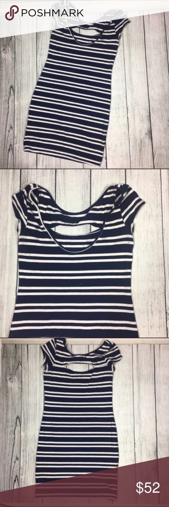 """Striped bodycon dress 👗 Absolutely stunning navy blue with white stripes bodycon dress. Has a very sexy slot in the front where the chest area is. Used only once so still in a very good condition. Made out of 96% cotton and 4% spandex materials. MEASUREMENTS: 34"""" length and bust 16"""" ❤ Guess Dresses Mini"""