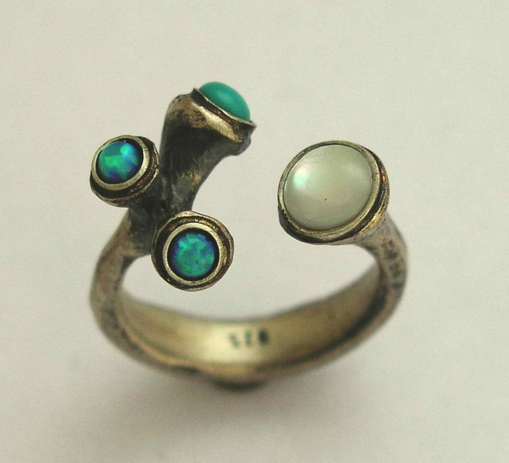 Sterling silver with a shell and turquoises
