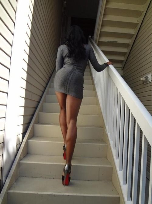 Great toned legs in mini and hose ascending stairs ...