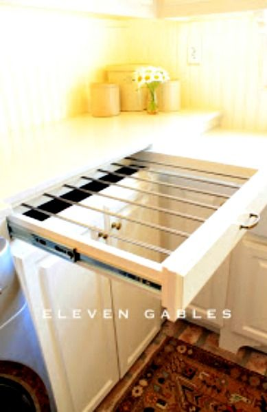 A pull - Out Clothes Drying Rack ~Great idea...  takes up less room and it's hidden when not in use