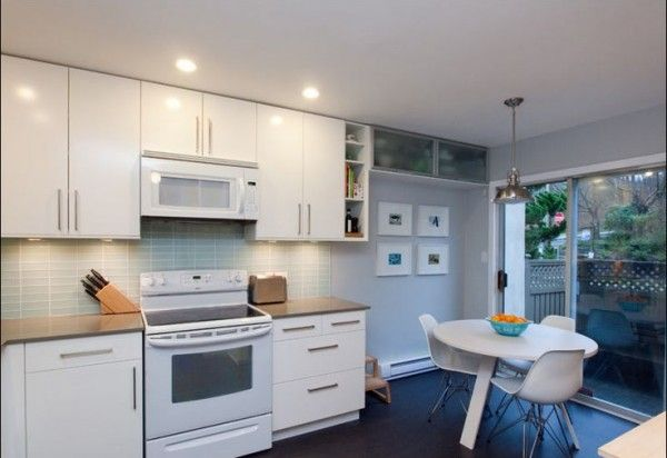 ikea kitchen countertop installation aboard modular storage cabinets on white vinyl laminate also round dining table over black linoleum floor