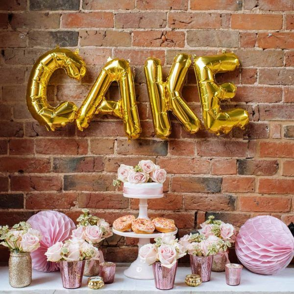 15 Creative Wedding Cake Table Backdrops available to buy online from @theweddingomd