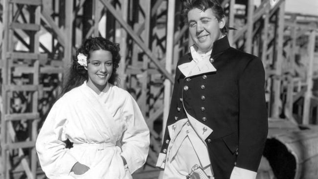 "Movita Castaneda, left, and Charles Laughton on the set of the 1935 film ""Mutiny on the Bounty."""