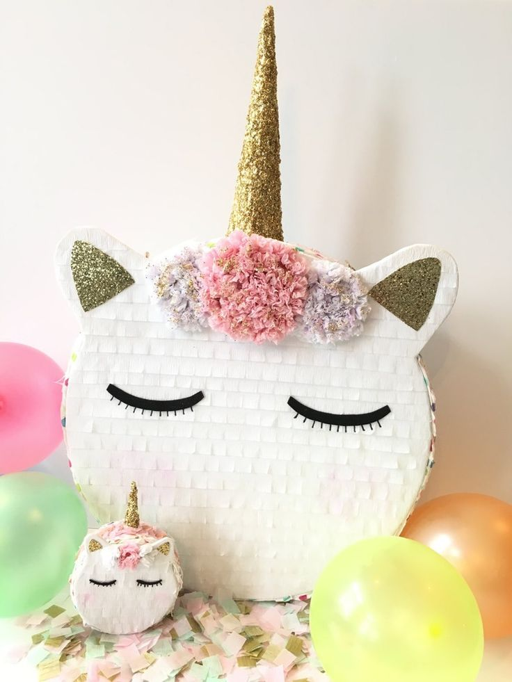 A unicorn piñata is a must-have at your next themed party.