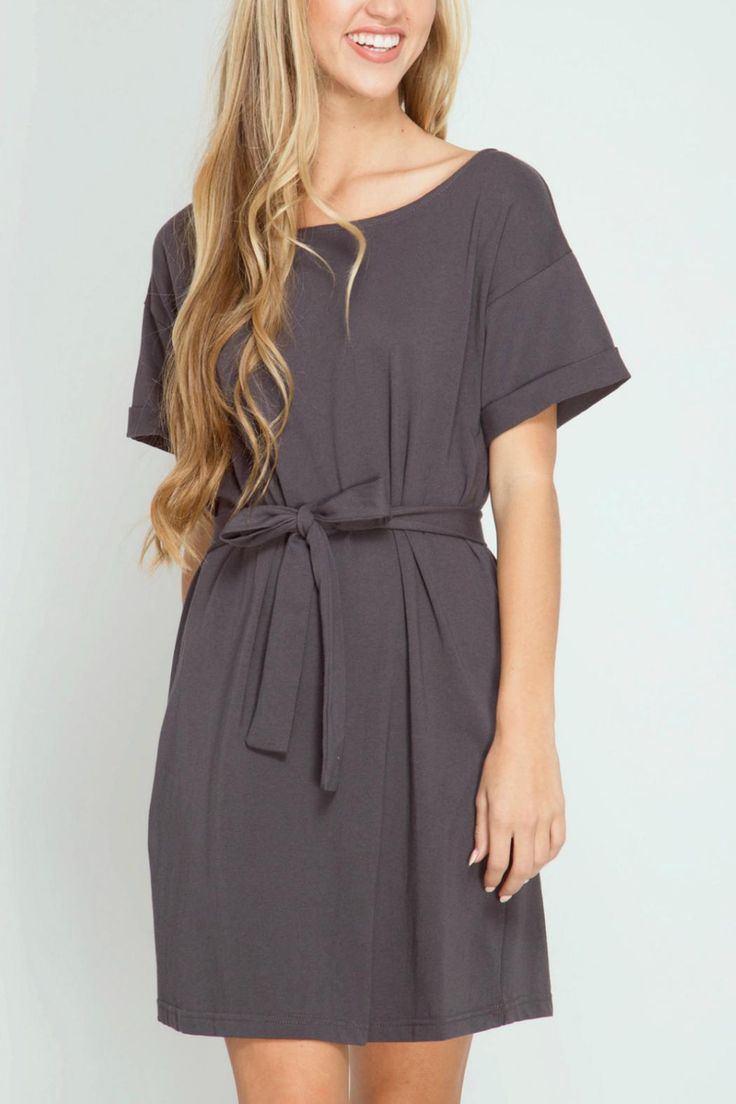 Half sleeve dress with tunnel waist tie. Sleeves are rolled at the edge. V - back detail with scoop neck front. Charcoal in color. Hand wash cold separately no bleach hang to dry.  Waist-Tie Dress by She  Sky. Clothing - Dresses Iowa