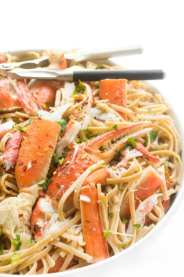 Sweet snow crab legs are tossed with whole wheat linguine in a light and fragrant white wine garlic sauce.