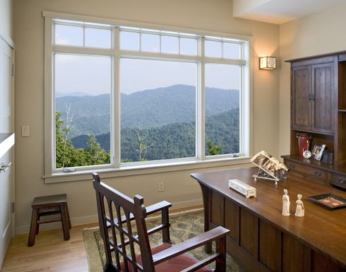 Casement windows surrounding picture window with transom for front room.  2 please!