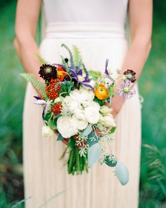 A smaller bouquet but with a lot of impact. The hanging seeded eucalyptus and eye-catching sword fern create the feeling that this bouquet has been picked of wildflowers from a nearby meadow.