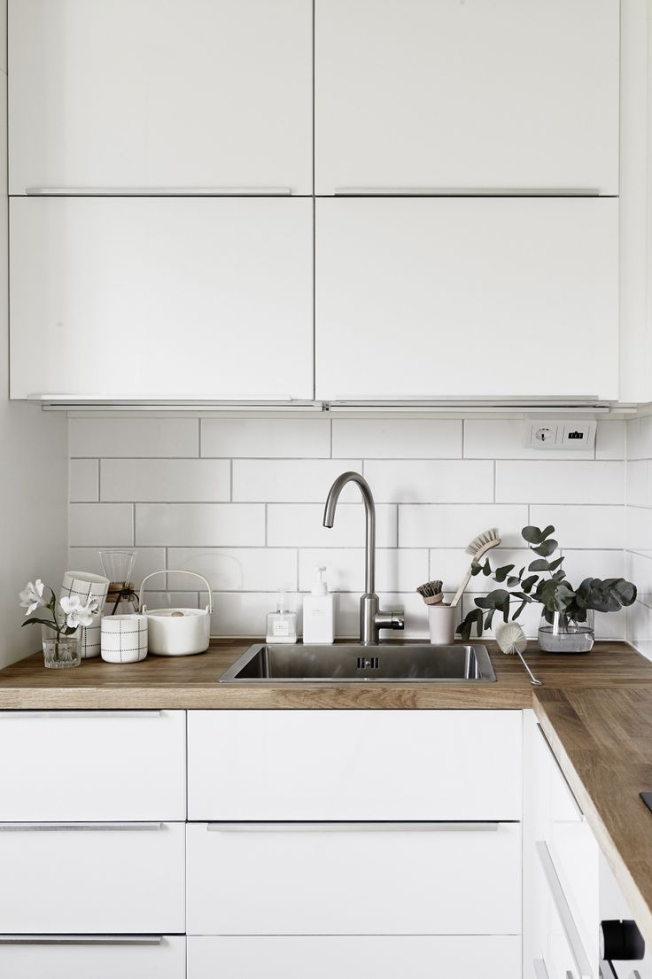 White modern kitchen, wooden worktop