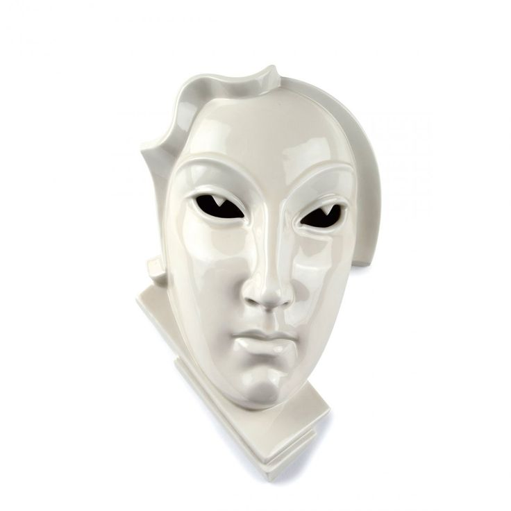 """Decorative wall mask, """"Day"""", 1926.  Made by Rosenthal branch factory, 1929. Porcelain, white, glazed, G. SCHLIEPSTEIN, 402. Dimensions: 23,5 x 15,8 cm. Private collection."""