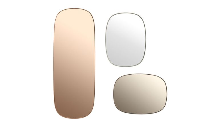 Muuto's Scandinavian mirrors structure the room with their bold curves and seemingly 3D effect